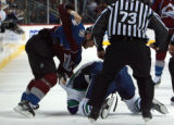 DM0289   Colorado Avalanche Ian Laperriere drags Vancouver Canucks Jeff Cowan to the ice as the...