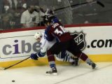 DM0580   Colorado Avalanche defenseman Kurt Sauer puts Vancouver Canucks Alex Burrows onto the...