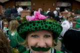 DM0290   North Dakota fan Dawn Stoe of Grand Forks N.D. sports a green mustache at Brooklyn's...
