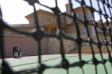 Troy Lowrie, CEO of VCG Holdings, shoots tennis balls at his son in his multi-million dollar home...