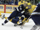 DM1597   Notre Dame's Christiaan Minella, left, battles with Michigan's Scooter Vaughan in the...