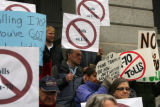 Signs against tolling I-70  during a protest against the proposed I-70 tolls on the west steps of...