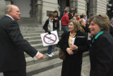 L to R: Sen. Andy McElhany (cq) R-Colorado Springs, chats with JoAnn Sorensen  (cq) and Joan...