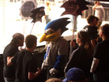Students from Liberty high school in Missouri and mascott Blue Jay cheer on their team during...