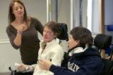 (from left) Physical Therapist, Rachel Carter (cq) helps her patients, Penny Crom (cq) and Casey...