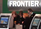 Ticket agents work the Frontier Airlines ticket counter at DIA Wednesday April 11, 2008. Frontier...