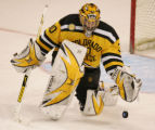 [ JOE0133 ] Colorado College goalie Richard Bachman clears the puck against Michigan State in the...