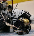[ JOE0384 ]  University of New Hampshire center Mike Radja (22) collides with UNH goalie Kevin...