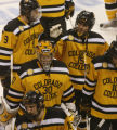 [ JOE0728 ] Colorado College Nate Prosser (15) pats goalie Richard Bachman on the head as they...
