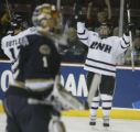 New Hampshire's Jerry Pollastrone celebrates his second goal of the  first period against Notre...
