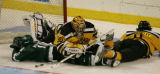 Colorado college goalie Richard Bachman is knockeed out  of the goal in the third period  of CC's...