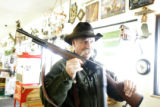 0250 Timm Armstrong, CQ, owner of the Silverheel, holds a 45.70 rifle , which is also know as a...