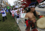 DM0268   Omar Morales, a dancer with the Tlaloc Aztec Dance Group leads hundreds of students from...