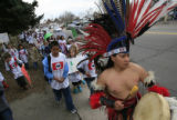 DM0321   Omar Morales, a dancer with the Tlaloc Aztec Dance Group leads hundreds of students from...