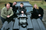 Grandson Daniel Donnelly, 9 sits a top the Mad Max roadster replica owned by his grandparents...