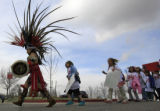 DM0187   Omar Morales, a dancer with the Tlaloc Aztec Dance Group leads hundreds of students from...
