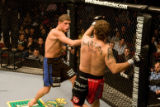 Joe Lauzon, left, takes a swing at Jason Reinhardt in an Ultimate Fighting Championship event on...