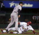 Jayson Nix forces out Skip Schumaker in the 1st inning of the Colorado Rockies against the St....