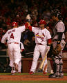 Yadier Molina, left is congratulated by Adam kennedy after a solo shot in the 5th inning of the...