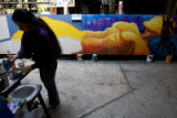 DM1297   Lady Pink, a world renowned graffiti artist from New York, works on a mural in a Denver...