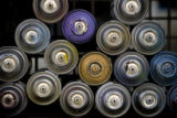 DM1301   Empty paint cans are stacked up in a crate in a denver warehouse where 15 local and...