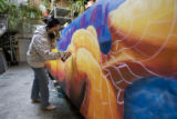 DM1311   Lady Pink, a world renowned graffiti artist from New York, works on a mural in a Denver...