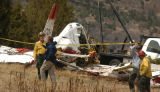 NTSB and fire officials examined the wreckage of a small plane on Wednesday afternoon along...