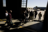 DM1998   About 40 of Colorado's Vietnam veterans walk out of hangar 909 to a waiting plane that...