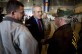 DM2054   Gov. Bill Ritter shakes hands with Robert Doggett, a Marine veteran who served in...