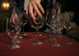 Guy Lenior (cq), who works for Fortessa of Canada tableware and Schott Zwiesel glasses gives a...