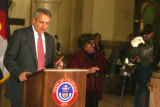 Gov. Bill Ritter (cq) speaks before signing  three animal-themed bills into law with the help of a...
