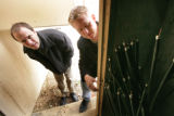 Tom Nats, Director of Hosting and Brandon Hieb Director of Operations (l-r) looks into a cabinet...