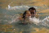 DM0079   Vienna Danna, 3, swims at the Recreation Center at Eastridge with her dad, Paul, in...