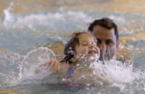 DM0080   Vienna Danna, 3, swims at the Recreation Center at Eastridge with her dad, Paul, in...