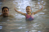 DM0084   Vienna Danna, 3, swims at the Recreation Center at Eastridge with her dad, Paul, in...