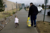 DM0090   Vienna Danna, 3, walks into the Recreation Center at Eastridge with her dad, Paul, on a...