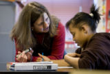 DM2433   Teacher Amy Campbell helps Jazzmine Tate as she works on a short descriptive paragraph in...