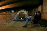 DM2467   Scott Anderson, 39, of Lakewood lounges in a chair outside the tent he set up outside...