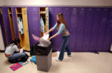 (Lt. to Rt.) Students Ana Cortes (cq), 17, and friend Zayra Novoa (cq), 15, clean out their...