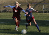Class 5A Jefferson County League Girls soccer Dakota Ridge's  #18 Jenny Hutton moves races to the...