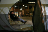 DM2559   Scott Anderson, 39, of Lakewood sits in a chair outside the tent he set up outside Coors...
