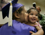 Yuri Frias, 18, cq, a single mother, of Denver, gives her 1-year-old daughter, Cherish, cq, a big...