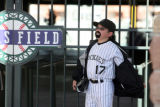 Nick Besman (cq), 10, AKA Todd Helton (cq), waits outside Coors Field early Friday  April 4,2008....