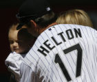 [ JOE0133 ] Colorado Rockies first baseman Todd Helton leans to kiss Kaige Kennedy, the 16-month...