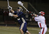 In boys Lacrosse Mullen's goalie #16 James Standley leaves the net followed by  Regis' #6 Luke...