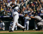 Rockies Garrett Atkins strikes out in the fifth inning of the Colorado Rockies home opener between...
