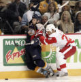 TNMH101 - Detroit Red Wings defenseman Brett Lebda, right, checks Nashville Predators center Scott...