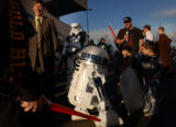 Denver Mayor, John Hickenlooper (left) is followed around by famed STAR WARS dorid, R2 D2 (CQ...