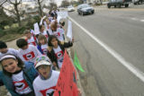 "DM0091   ""Si se puede"" chant Elena Del Carril, 10, front left, and Abby Schmid, 10, as..."