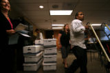 (301) Milton Austin, of Fieldworks, (right) wheels boxes of signatures for Petition 82...